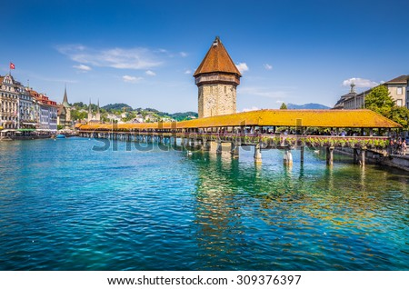 Historic city center of Lucerne with famous Chapel Bridge, the city's symbol and one of the Switzerland's main tourist attractions on a sunny day in summer, Canton of Lucerne, Switzerland - stock photo
