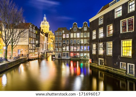 Historic city of Amsterdam, Netherlands at night - stock photo