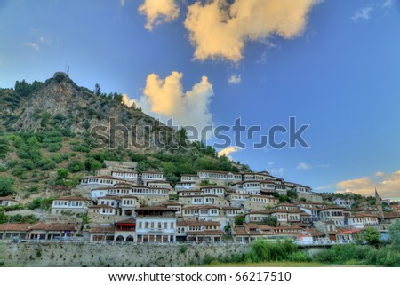 historic city of Berat in Albania at late afternoon with white houses gathering on a hill also called city of a thousand windows - stock photo