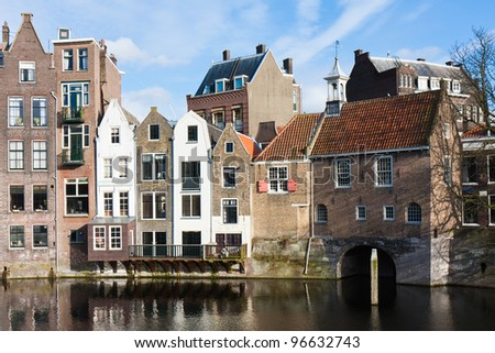 Historic cityscape along a channel in Delfshaven, a district of Rotterdam, the Netherlands - stock photo