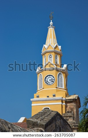 Historic Clock Tower (Torre del Reloj) above the main gateway into the historic walled city of Cateragena de Indias in Colombia - stock photo