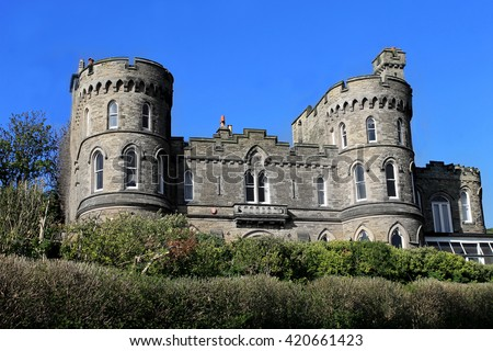 Historic English house with castle turrets, Scarborough, England. - stock photo