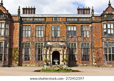 Historic English stately home in Cheshire, UK. - stock photo