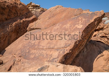 Historic engravings from the Stone Age in Namib - stock photo