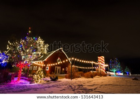 Historic farm decorated with Christmas lights. - stock photo