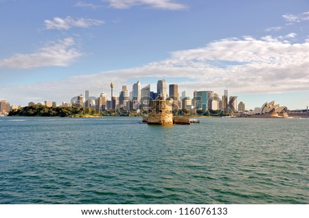 Historic Fort Denison and Sydney Skyline at Sunset - stock photo