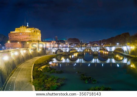 Historic fortress Castel Sant Angelo in Rome, Italy, wit the Angel's bridge, lit at night - stock photo
