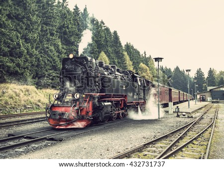 historic German black steam powered railway train at Schierke station, Schierke, Harz, Germany, Europe, vintage filtered style  - stock photo