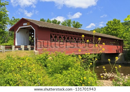 Historic Henry Covered bridge over the Walloomsac River e in Bennington, Vermont - stock photo