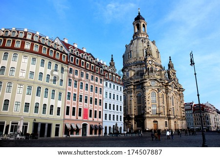 Historic houses and the Frauenkirche in Dresden in Germany - stock photo