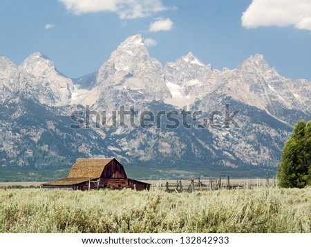Historic John Moulton barn and corral on Mormon Row in the Antelope Flats area of Grand Teton National Park, Wyoming - stock photo