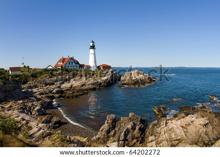 Historic Lighthouse - Portland Head Light is a historic lighthouse located on the rocky coast of Maine at Cape Elizabeth, southeast of the city of Portland. - stock photo