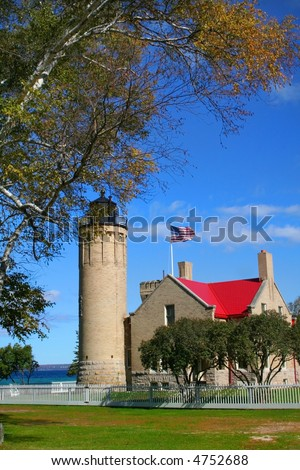 Historic Mackinac Light house with blue sky background - stock photo