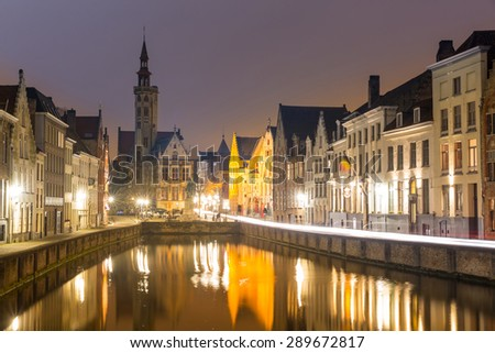 Historic medieval buildings in Bruges, Belgium at night. - stock photo