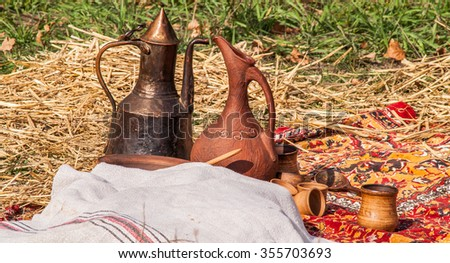 historic medieval earthenware or metal pitcher on holiday - stock photo