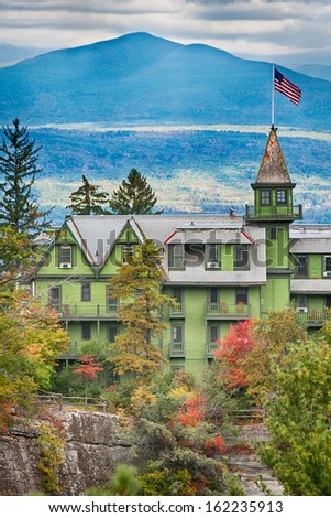 Historic Mohonk Mountain house in the autumn colors - stock photo