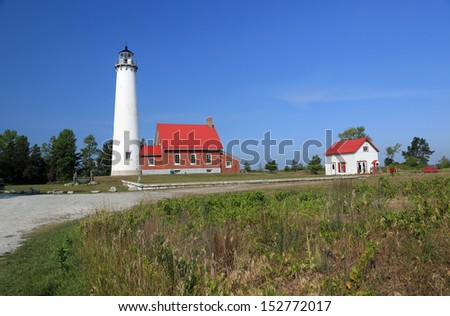 Historic Ottawa Point lighthouse in Tawas City, Michigan, on Lake Huron, built in 1853 - stock photo