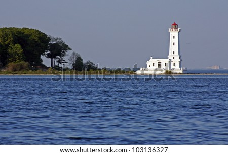 Historic Point Abino lighthouse on the Canadian shore of Lake Erie - stock photo