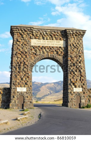 historic Roosevelt Arch at the north entrance of Yellowstone National Park - stock photo