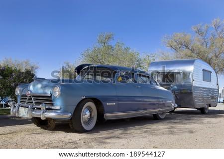 HISTORIC ROUTE 66, ARIZONA, USA - April 23, 2014:  1956 Hudson Commodor and 1954 Vacashunette trailer on historic Route 66, Arizona on April 23, 2014. - stock photo