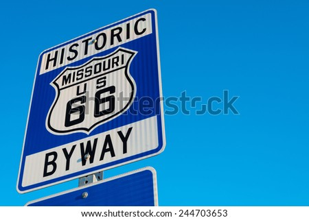 Historic route 66 highway signs in Missouri USA. Blue sky background - stock photo