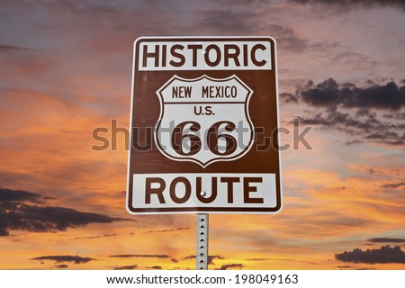 Historic Route 66 New Mexico sign with sunset sky. - stock photo