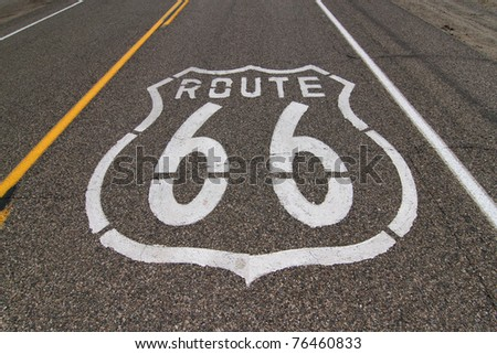 Historic Route 66 sign on highway pavement. - stock photo