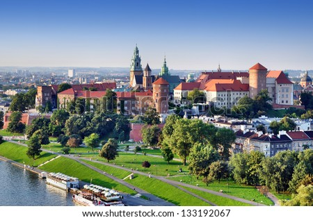 Historic royal Wawel castle in Cracow, Poland with park and Vistula river. Aerial view at sunset. - stock photo