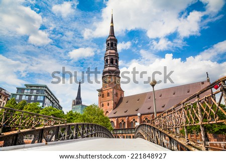 Historic St. Catherine's Church (Katharinenkirche), one of the five principal Lutheran churches (Hamburger Hauptkirchen) with old bridge in Hamburg, Germany - stock photo