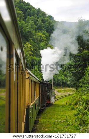 Historic steam train in Maramures, Romania (Mocanita) - stock photo