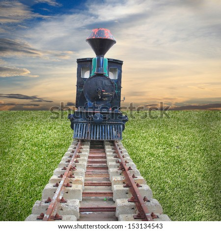 historic steam train passes through the fields - stock photo