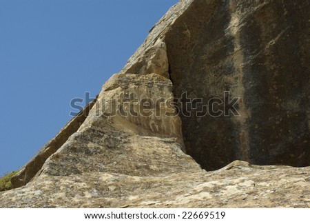 Historic stone carvings in Gobustan - stock photo