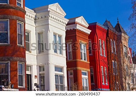 Historic urban architecture of Mount Vernon Square in Washington DC. Colorful residential row houses under bright afternoon sun. - stock photo