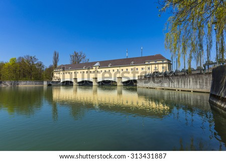 Historic weir at the river Isar in Munich, Germany - stock photo
