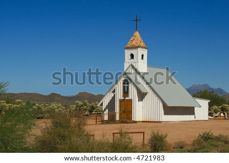Historic white clapboard church served parishioners in the harsh, arid Arizona desert - stock photo