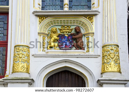 historical architecture detail with blazon in Brugge Belgium - stock photo