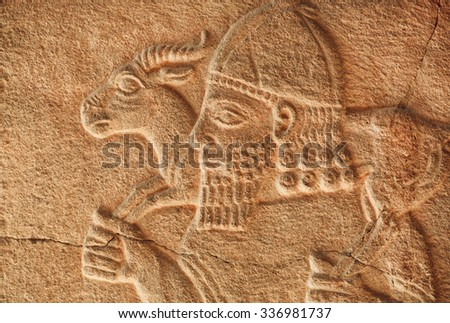 Historical Assyrian relief of farmer with goat. Exhibition of artifacts in Pergamon Museum, Berlin.  - stock photo