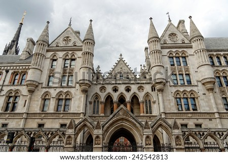 Historical building and entrance of Royal Courts of Justice in London England - stock photo