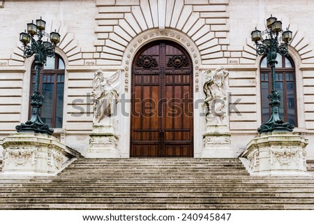 Historical buildings and architecture details in Rome, Italy: the entry door of the Italian Parliament Building - stock photo