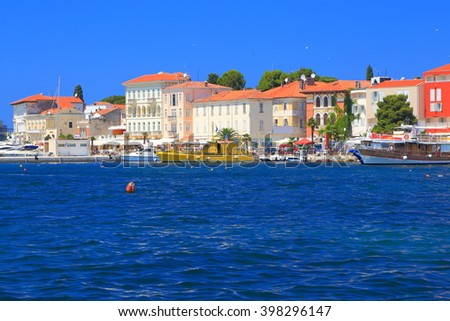 Historical buildings on the Adriatic sea shore,, Porec, Croatia - stock photo