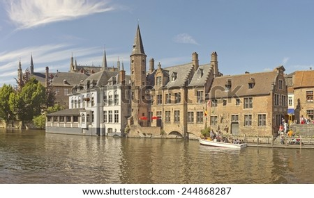 Historical buildings on the canal bank in Brugge, Belgium - stock photo
