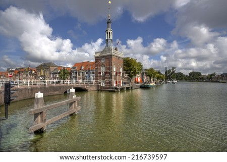 Historical customs tower at a canal in Alkmaar, Holland - stock photo