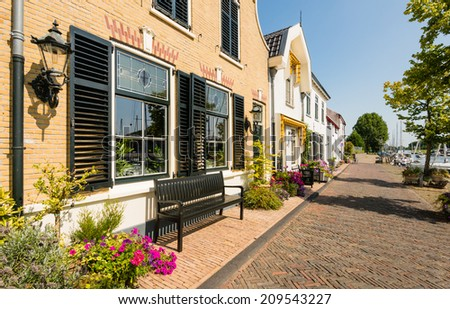 Historical facades of houses in an old village in the Netherlands on a sunny day in the summer season. - stock photo