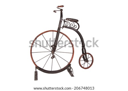 Historical high-wheel bicycle on a white background - stock photo