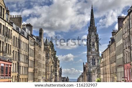 Historical houses and church tower on the Royal Mile main street of Edinburgh, Scotland, UK - stock photo
