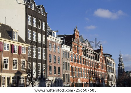 Historical houses and the Mint Tower in the old part of Amsterdam, Holland - stock photo
