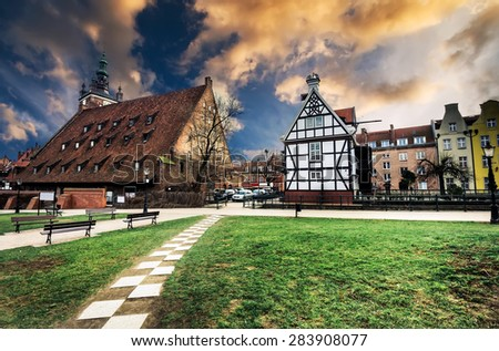 Historical Miller's House on the Mill Island in Gdansk and other old houses in cener of Gdansk, Poland - stock photo