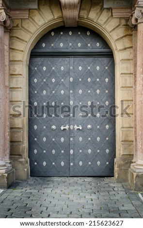 Historical Ornate Steel Door in a Stone Entry with Pillars, Prague, The Czech Republic - stock photo