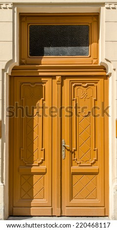 Historical Ornate Wooden Door with Glass Pane, Prague, The Czech Republic - stock photo
