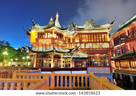 Historical pagoda stile building in Shanghai at night - stock photo